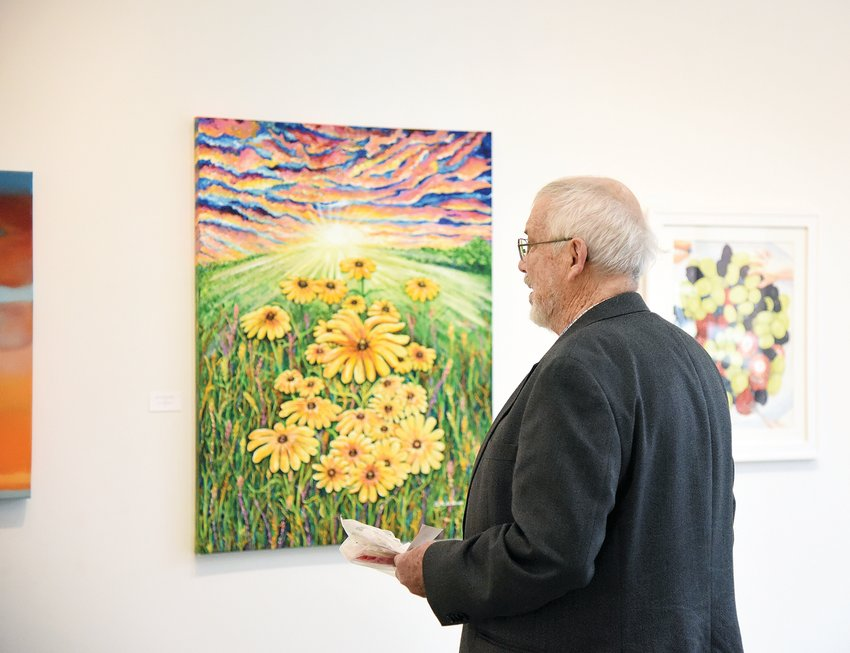 """Friday morning, Dave Carter, of Cape Girardeau, judges the Sedalia Visual Art Association show """"Spring Fling"""" at the Hayden Liberty Center. The exhibit opened Friday and will show through May 9."""