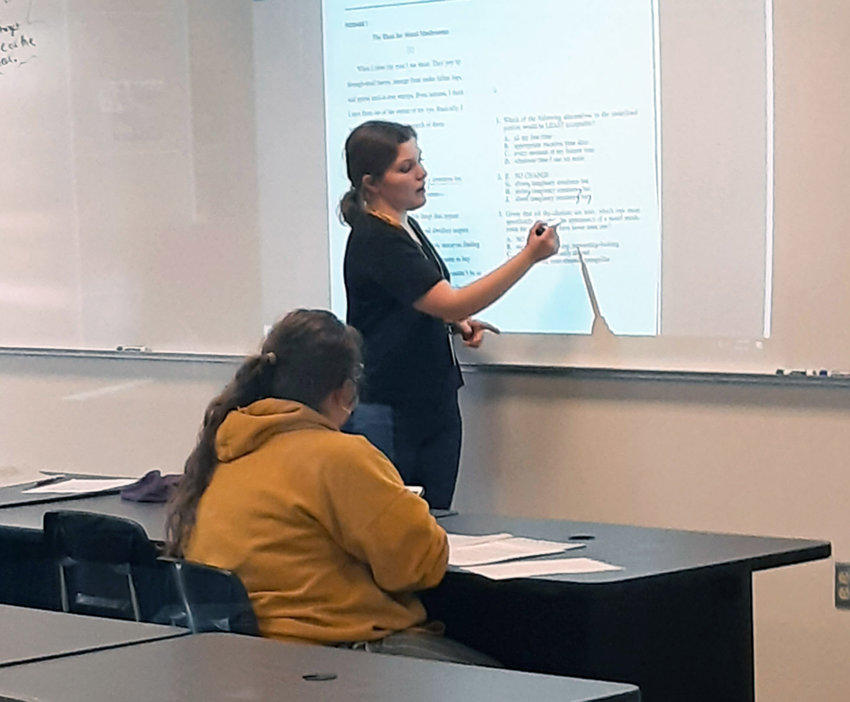 Smith-Cotton junior Alisa Sonnik leads an ACT workshop for fellow students on Tuesday, April 6, in a classroom at the high school. The workshop is part of a National Honor Society program.