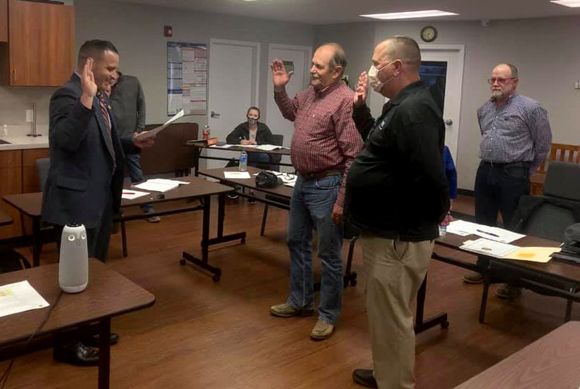 Pettis County Clerk Nick La Strada, left, swears in newly-elected members Mike Brown, center, and Steve Davis, left, to the Pettis County Ambulance District Board of Directors during Tuesday night's meeting in the PCAD Education Building. Brown is starting his second term and is vice chair of the board.