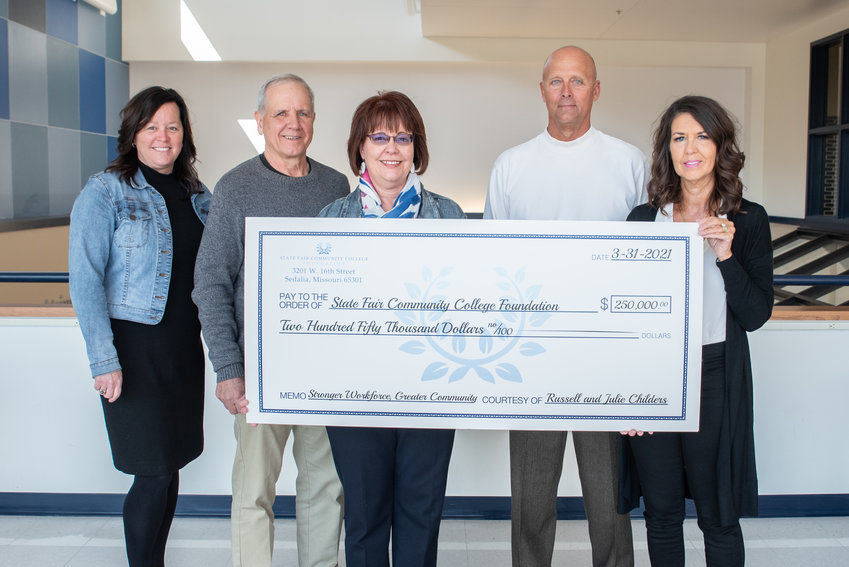 Russell and Julie Childers recently donated $250,000 to SFCC's Stronger Workforce, Greater Community capital campaign. From left, Mary Treuner, SFCC Foundation executive director; Steve Ellebracht, SFCC Foundation Board of Directors vice president;  Dr. Joanna Anderson, SFCC president; and the Childers.