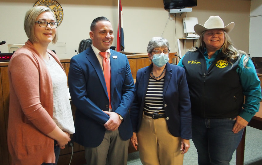 From left, Amanda McClain, Pettis County Clerk Nick La Strada, Ann Richardson and Brandy Von Holten at Friday's swearing-in to the Pettis County Health Center Board of Trustees at the Pettis County Courthouse.