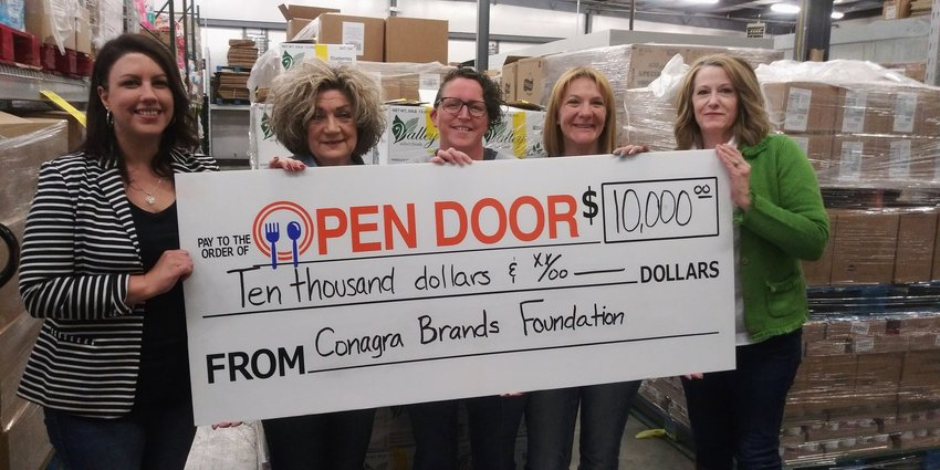 Open Door Pantry received a grant from Conagra Brands Foundation for $10,000 to Feed the Community. From left are Executive Director Amanda Davis, Case Manager Suzy Taylor, Case Manager Megan Simon, Warehouse Manager Victoria Powell and Director of Development Jennifer Taylor.