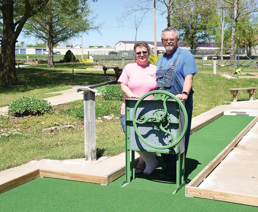 Erle and Susan Price, owners of Leisure Park, stand on the miniature golf course Friday afternoon. After being closed for more than a year due to COVID the park will open this weekend at 1 p.m. Saturday and Sunday.