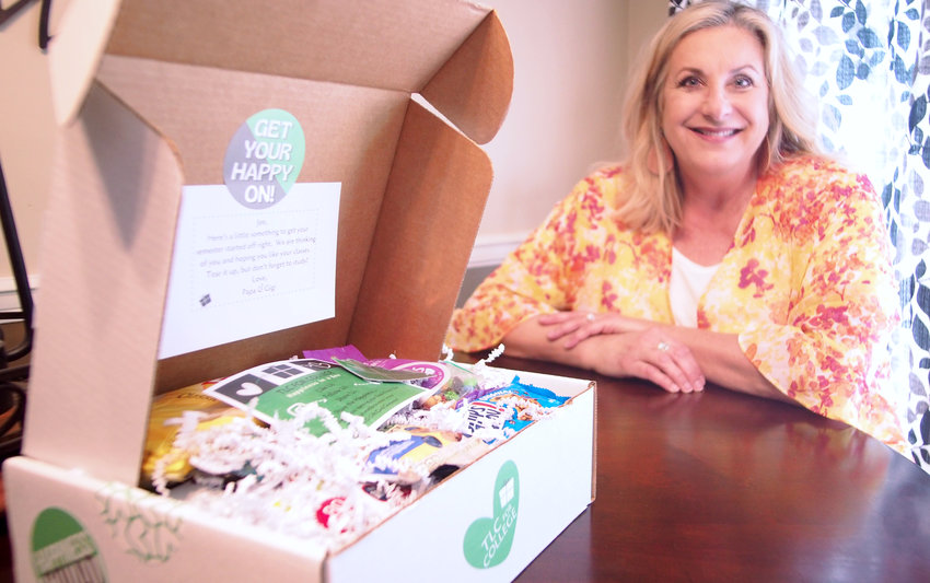 Marina Scheiner, seen at her home office Wednesday, started TLC for College, a small business that sends gift boxes to college students.