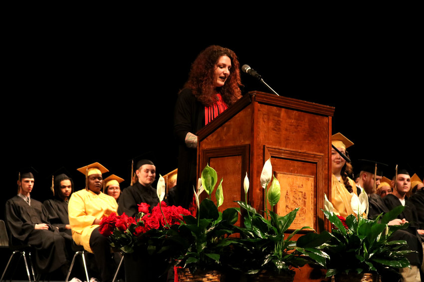 """Keynote speaker Breanna (Buso) Handley, who graduated from Whittier High School in 2010, tells students about her past inspiration, especially a book given to her by a teacher called """"See You at the Top,"""" during Whittier's graduation ceremony Friday night in the Heckart Performing Arts Center at Smith-Cotton High School."""