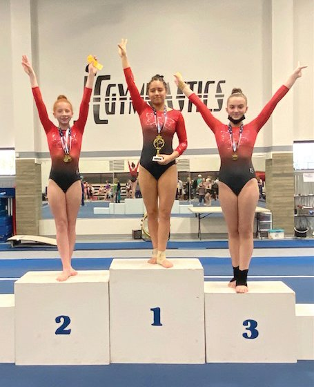 From left is Leap of Faith Gymnastics, Cheer and Tumbling LLC's Xcel Gold winners Cassidy Bentch, Jasmine Lopez and Tessa Martin. The trio participated in the 2021 Heart of Missouri State Championships on May 1 in Jefferson City.