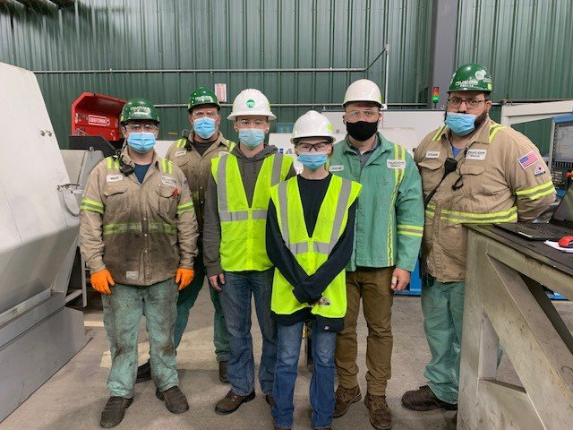 SFCC's Work Experience Week students and employees at Nucor Steel Sedalia are, from left, Nucor machinists Miles Paulus and Justin Moon, students Shae Childers and Dezirae Knibb, SFCC instructor Justin Wright, and Nucor Roll Shop Lead Steven Thomas.