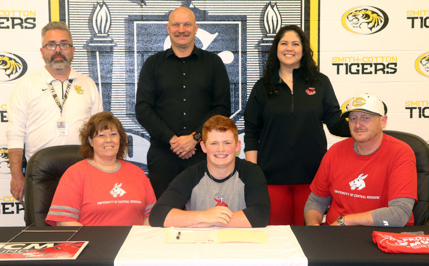 Smith-Cotton High School senior Blake Osteen has accepted a Marching and Concert Band Scholarship from the University of Central Missouri in Warrensburg. Seated with him are his parents, Melanie and Dane Osteen; back row, from left: Smith-Cotton Principal Wade Norton, S-C Director of Bands Grant Maledy and Dr. Julia Baumanis, assistant director of bands and director of athletic bands at UCM.