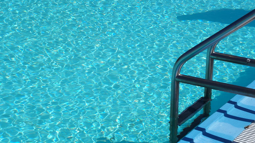 The crystal clear waters of the Centennial Park pool are seen Thursday. Pool owners may find tablet chlorine in short supply this summer after a hurricane and fire destroyed the country's only plant.