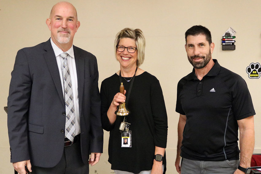 Sedalia School District 200 Superintendent Steve Triplett, left, presents Pettis County Early Childhood Center nurse Sheri Zumsteg with the Superintendents' Bell Ringer Award on Thursday, May 27, at the school. At right is PCECC Principal Joel Sherman.