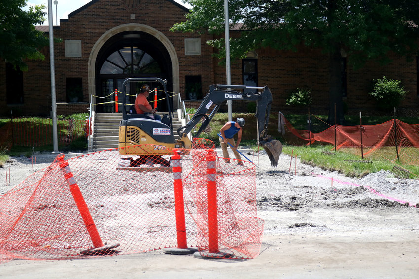 Construction workers repair the front entrance near the William C. Hopkins Student Service Center and main parking lot on Wednesday at State Fair Community College. This is part of a project to repair three entrances on campus, along with deteriorating sidewalks.
