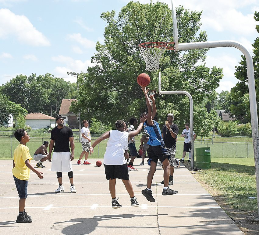 During the 2018 Juneteenth celebration at Hubbard Park, several young people play a game of basketball. This year's celebration will begin at 3 p.m. Saturday at Hubbard Park.