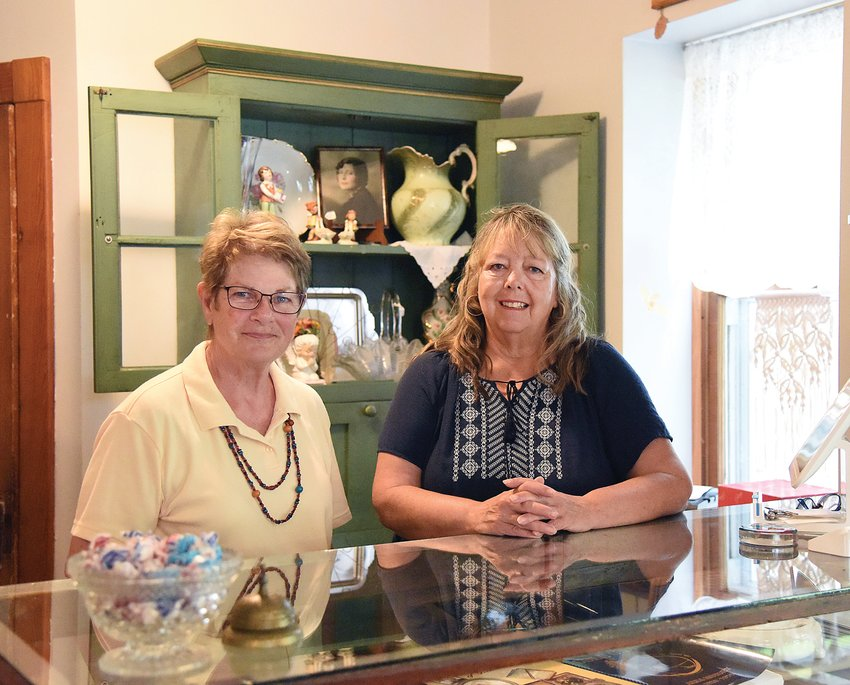 Wednesday morning, Roxy Viebrock, right, owner of The Hotel Bellview Antiques, Vintage and More in Cole Camp, stands with one of the store's vendors, Linda Eckhoff with Granny's Attic. Viebrock opened the store on June 1 and it features antiques, vintage clothing and other unique items.