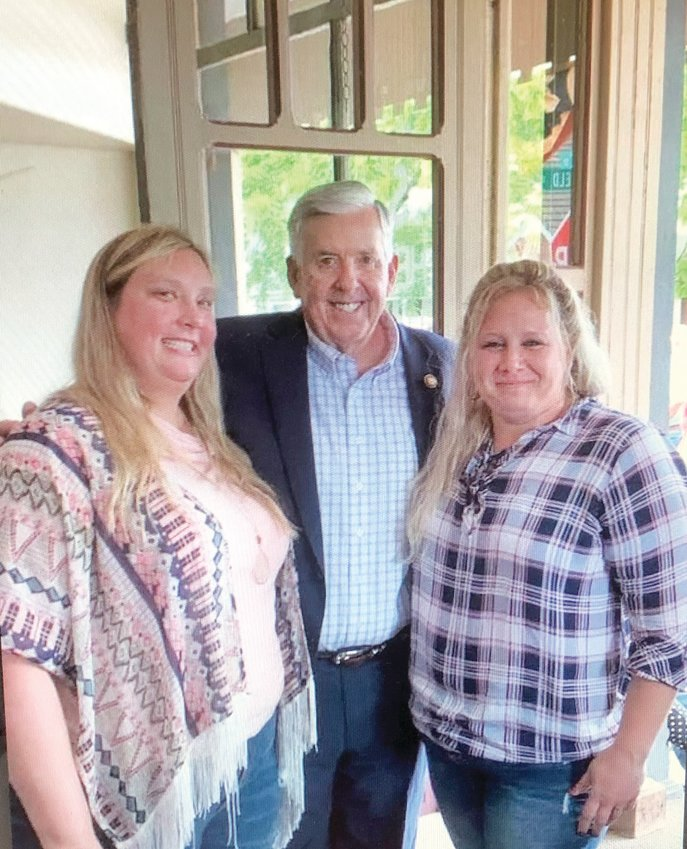 Andrea Waynick, right, and Crystal Casteel, co-owner of CC's Butcher Shop in Cole Camp, stand with Gov. Mike Parson last Thursday afternoon. Waynick, a long-time food service worker, enjoys giving back to the small community of Cole Camp.