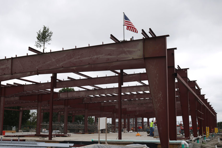 A small tree and an American flag are placed on top of the steel structure that will eventually be the Olen Howard Workforce Innovation Center during a top off ceremony Thursday morning at State Fair Community College. According to SFCC Director of Building Management Justin O'Neal, a top off ceremony occurs after the last main steel structure for a building goes up.