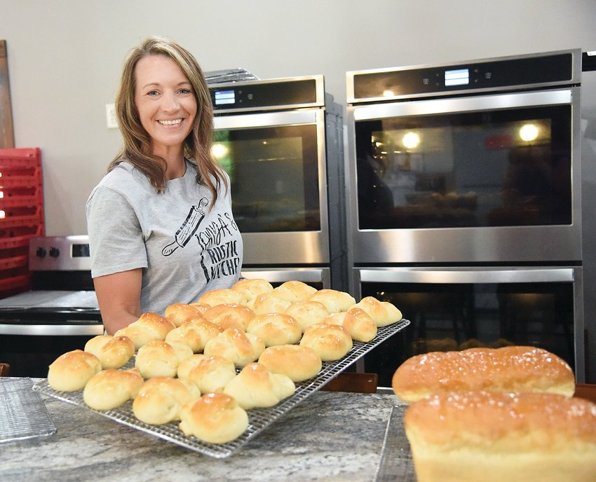 Tonya Nelson, of Cole Camp, holds a tray of her freshly baked rolls just as her late grandmother Evelyn Goosen did in a 1997 Democrat food article. Nelson, who owns Tonya's Rustic Kitchen LLC, learned to bake from her grandmother and is carrying on her yeast bread traditions.