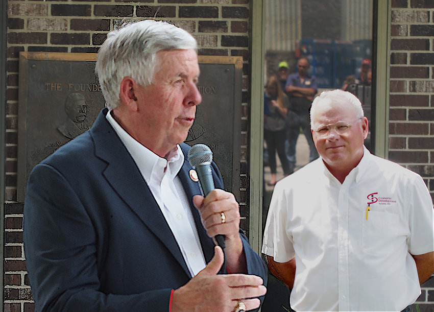 Gov. Mike Parson congratulates employees of WireCo WorldGroup on the announcement of a $15 million expansion at their Sedalia manufacturing and distribution facility. Pettis County Presiding Commissioner David Dick listens to Parson address the crowd of more than 100 Thursday.