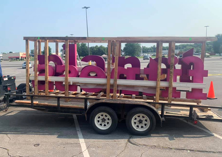 On Tuesday, July 20, the neon sign for the upcoming Planet Fitness location is seen in the Thompson Hills Shopping Center parking lot before it is installed. The gym will be at 3117. W. Broadway Blvd. in the shopping center.