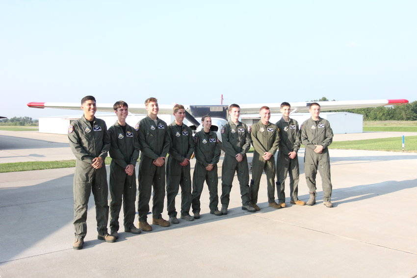 Newly graduated Flight Academy cadets pose for a picture after receiving their patches and wings Friday, July 23, at Max B. Swisher Skyhaven Airport. From left, Jonathan Willis, Nathanyal Hanson, Bruce Reinhard, Tyler Butler, Paige McCarty, Leyton Rainbolt, Adam Winters, Jared Calderon and Nicolas Quigley.