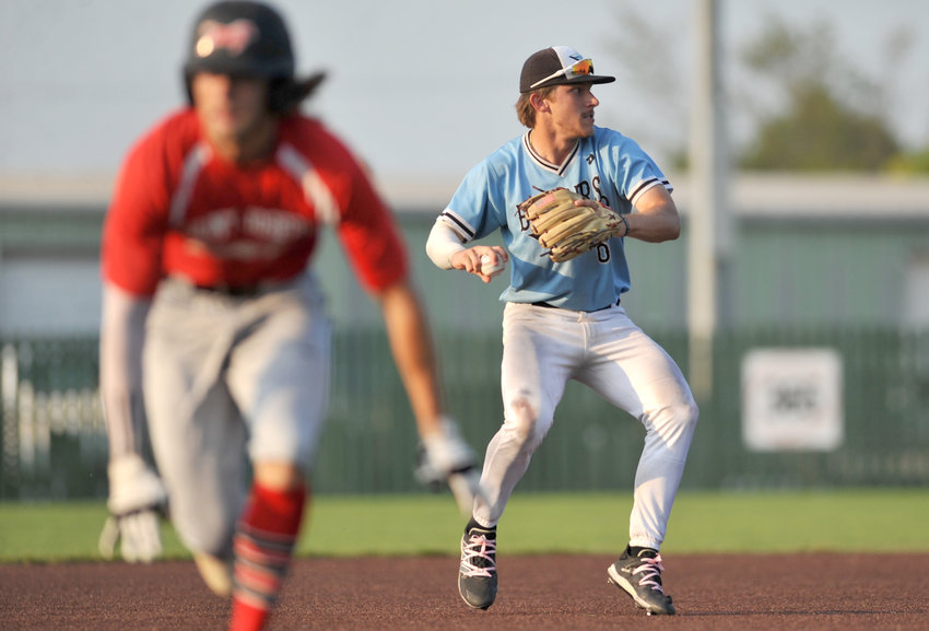 Sedalia Bombers shortstop Spencer Nivens prepares a throw Wednesday during a MINK League Championship series contest against the St. Joseph Mustangs at Liberty Park Stadium in Sedalia.