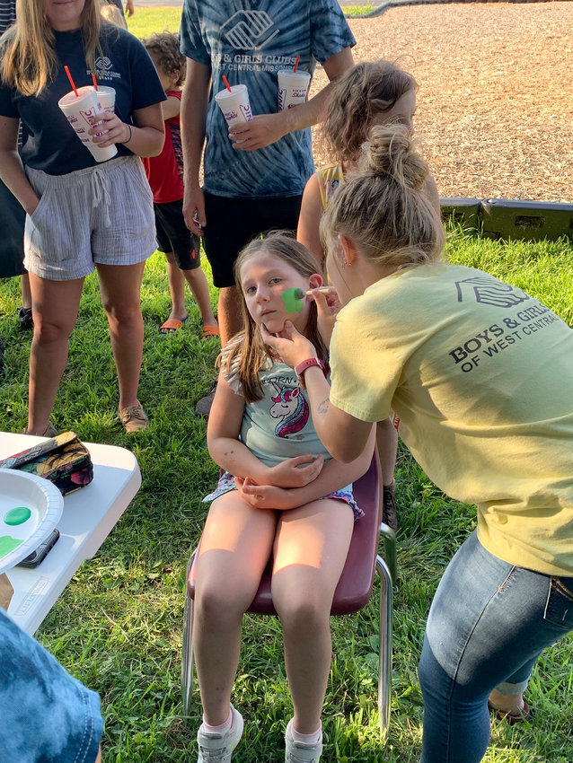 A Boys & Girls Clubs of West Central Missouri member paints a turtle on an attendee of the 2019 National Night Out event. This year, the event is scheduled for 5:30 to 7:30 p.m. Aug. 3 at Skyline Elementary.
