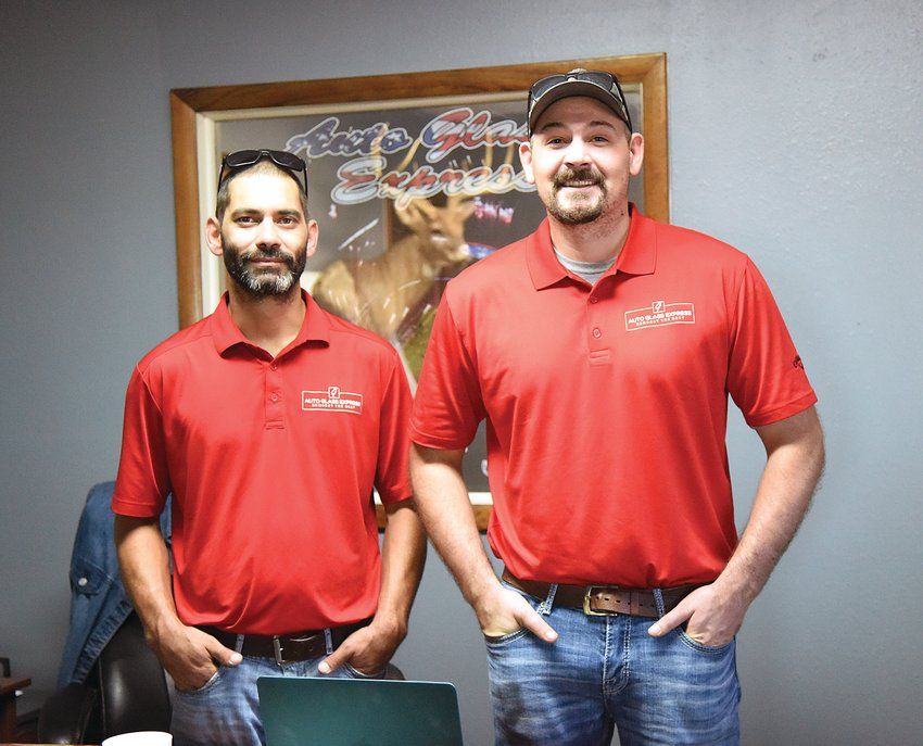 Derrick Goodman, left, and his cousin Brandon Goodman are the new owners of Auto Glass Express. Derrick's parents, Don and Rini Goodman, retired after 22 years on July 1. The men said they will offer the same services with a modern touch.