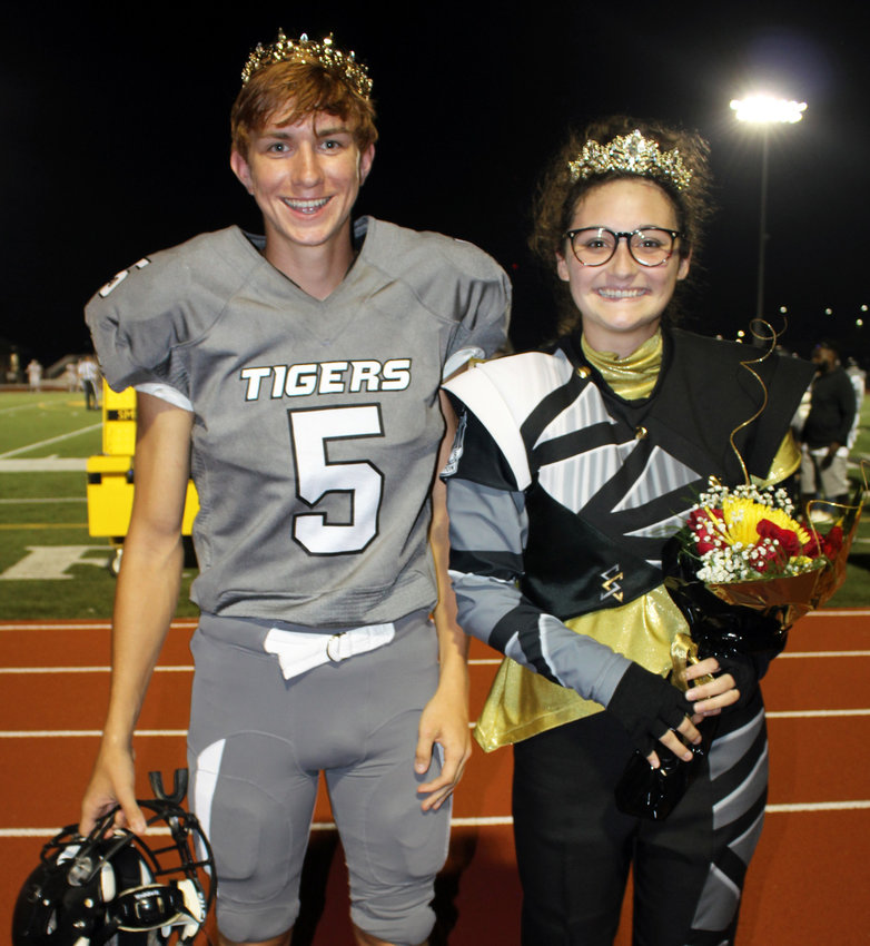 At halftime of the Smith-Cotton football game against Warrensburg High on Friday, Sept. 10, senior Anna Johnston, right, was named activities queen and senior Sam Cash was crowned activities king. Princess, not shown, was Bailey Brown. Johnston, who performs in the S-C Tiger Pride Marching Band, was nominated from National Honor Society. Cash, who plays soccer and football, was nominated as a senior class officer. Student votes determined the winners.