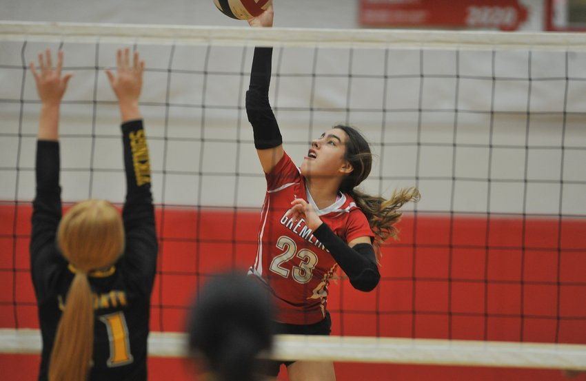 Junior Mariana Restrep attacks for Sacred Heart in the opening set of Thursday night's victory over the Lady Vikings in Sedalia.
