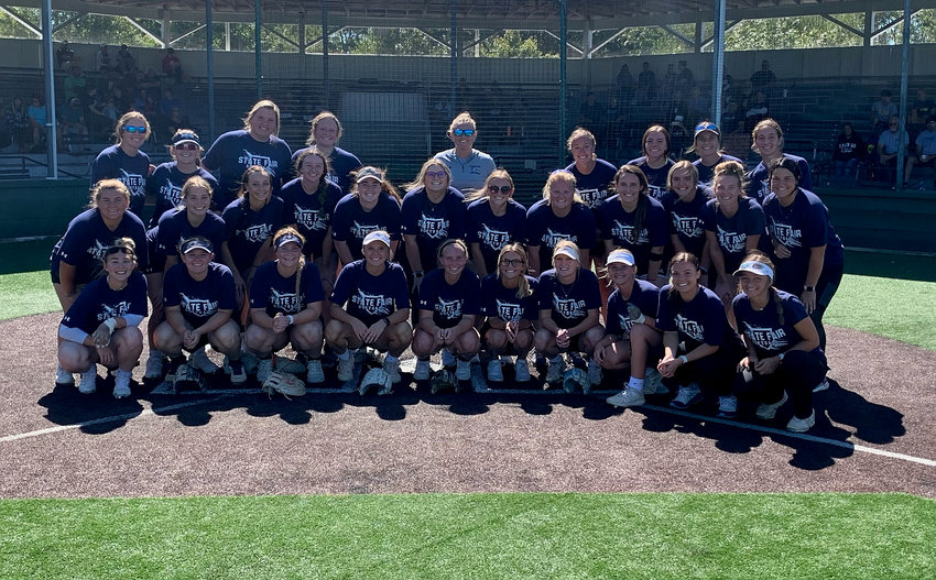 The Lady Roadrunners gather for a team photo on Sept. 25th when they participated in their 100-inning game at Liberty Park.