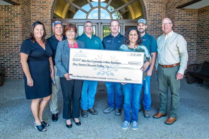 Nucor Steel Sedalia employees recently presented a $300,000 donation to the State Fair Community College Foundation's capital campaign to build the Olen Howard Workforce Innovation Center on the Sedalia campus. From left, Mary Treuner, SFCC Foundation executive director; Steve Ellebracht, SFCC Foundation campaign co-chair; Dr. Joanna Anderson, SFCC president; Tim Patterson, Nucor roll mill manager; Matt Way, Nucor environmental manager; Stephanie Garrett, Nucor controller; Cody Wissman, Nucor engineer; and Joe Fischer, SFCC Foundation campaign co-chair.