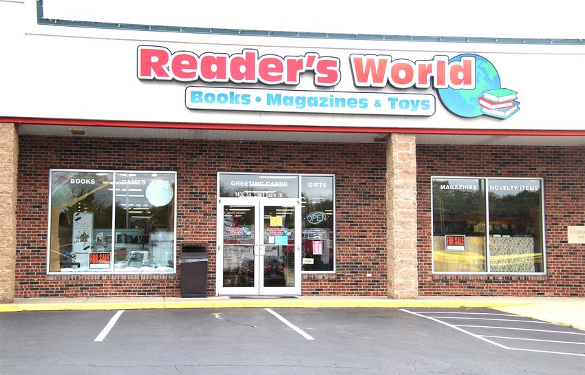 """""""For Sale"""" signs are seen in the front windows at Reader's World this week, hoping to catch the eyes of potential buyers. If there isn't a potential new owner by the last day of November, the store will go out of business."""
