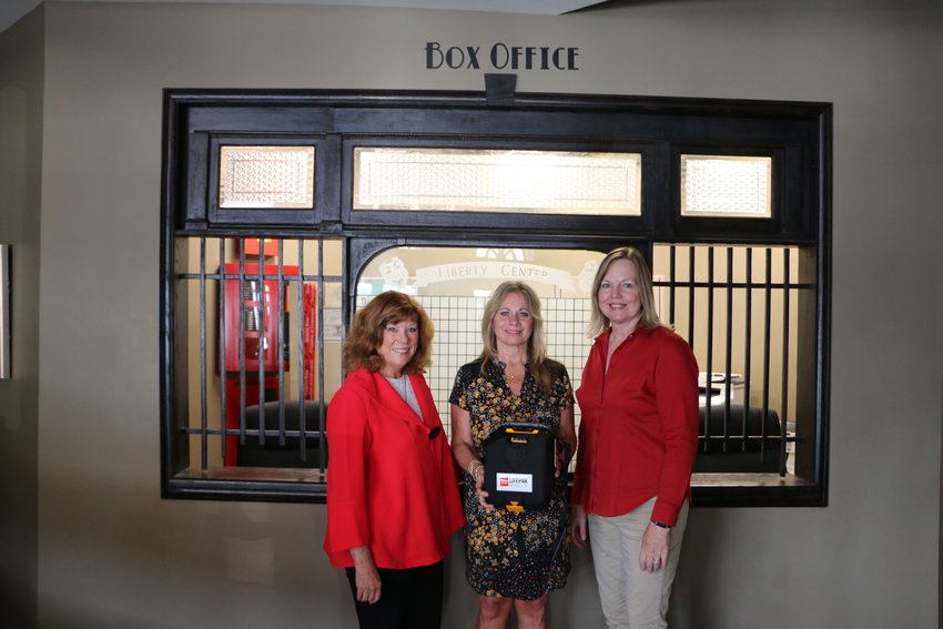 From left, Lori Wightman, Bothwell CEO and Wear Red Committee co-chair; Diane Burnett, Hayden Liberty Center Association for the Arts executive director; and Dianne Simon, Thompson Hills Investment Corporation property manager and Wear Red Committee co-chair.