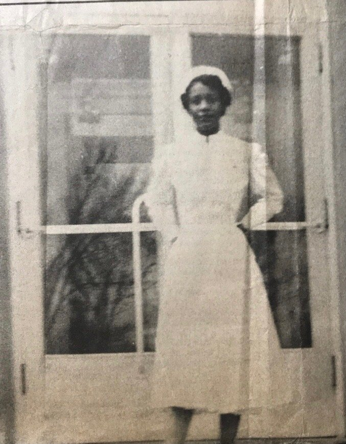 Lauretta Emerson in her nurse uniform in front of City Hospital #2 around 1951.