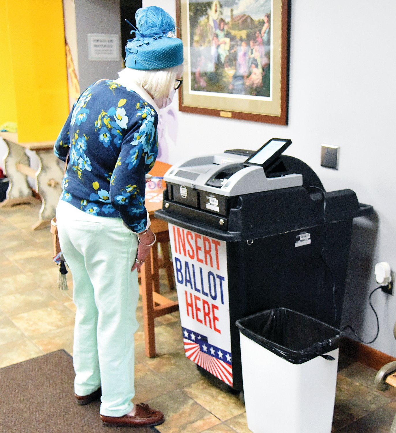 Chelsea Kehde, the 94th voter in Ward 2, makes sure her ballot is accepted Tuesday at First Baptist Church. At 1:37 p.m. there were 97 votes cast in the Municipal Election at First Baptist.
