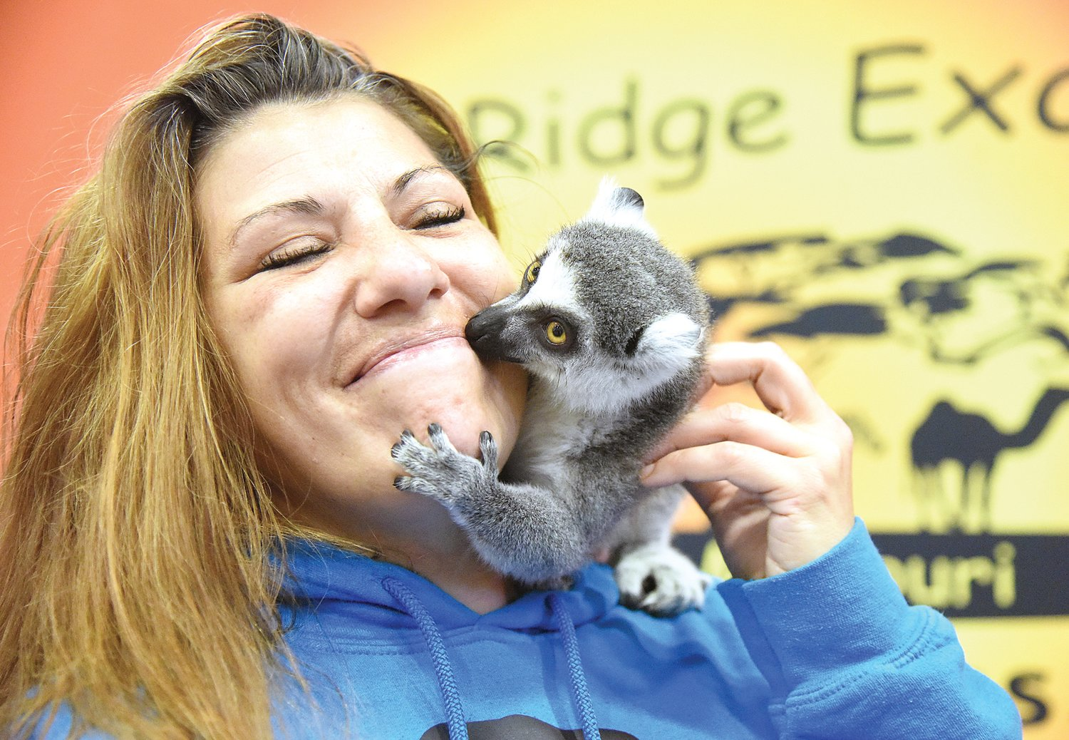 "During the Home and Garden Show Saturday, Jen Colantino, of Sedalia, gets a kiss from a lemur at vendor Thorni Ridge Exotics' booth. ""Oh, he's so sweet,"" Colantino said of the affectionate primate."