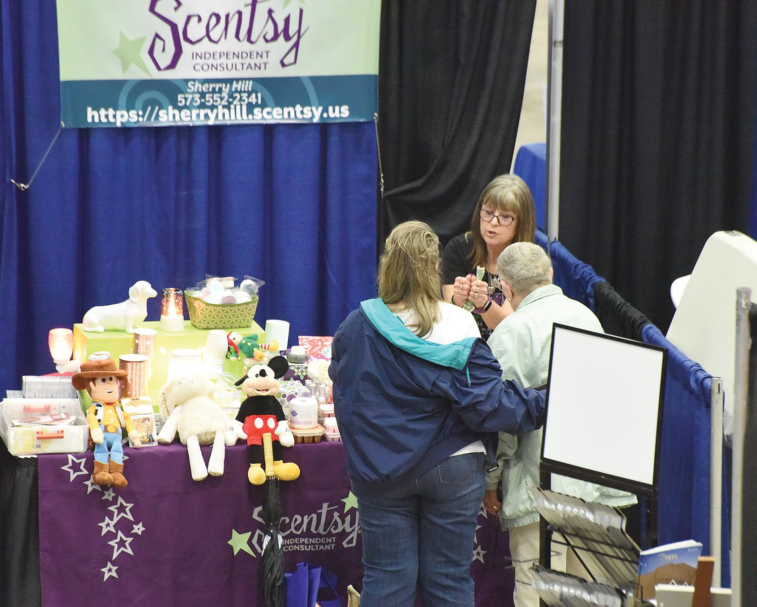 Sherry Hill, center, of Camdenton, talks with customers at her Scentsy booth Saturday at the Home and Garden Show. Hill said she thought the show would do well and bring out a lot of people because last year the event didn't happen due to the pandemic.
