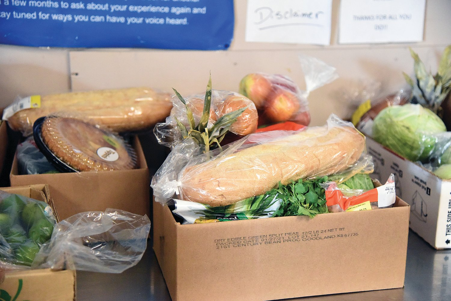 Open Door Pantry's food boxes are given to anyone who needs them. To keep everyone safe during COVID, staff and volunteers load the boxes in vehicles as people drive through.