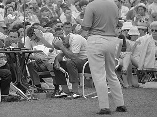 Roberto DeVincenzo with his hand over his head at the 1968 Masters after mistakenly signing par on his card instead of a birdie.  Consequently, the Argentine was forced to concede the tournament to Bob Goalby.