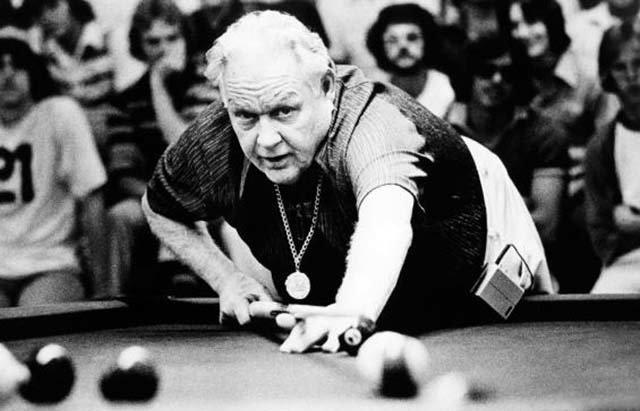 Minnesota Fats cuing for a shot.  An irrepressible showman, he was pocket billiards' greatest hustler.