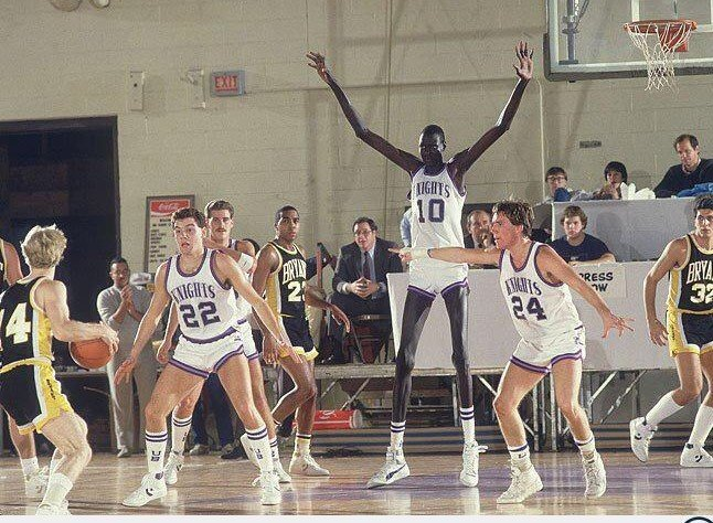 7-foot, 7-inch Manute Bol playing for the University of Bridgeport in 1984-85.  The following year, he would be the tallest player to be drafted into the NBA.