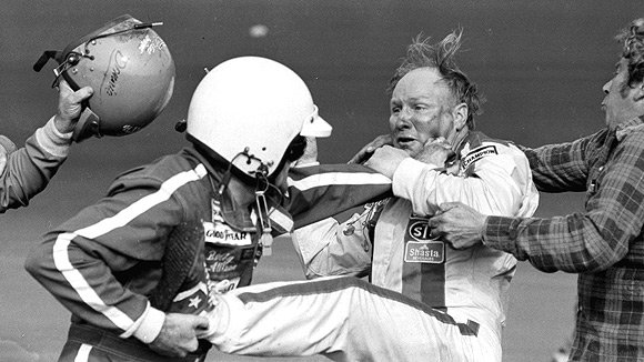 Allison and Yarborough brawling after crashing at the 1979 Daytona 500, the first race to be televised live from start to finish.  The images helped launch NASCAR's national following.