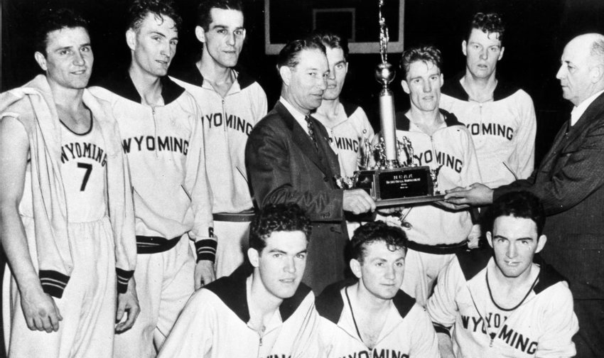 """The Wyoming Cowboys being presented with the 1943 NCAA Championship trophy.  Two days later, they would defeat St. John's in the first NCAA-NIT faceoff for the """"mythical national championship""""."""