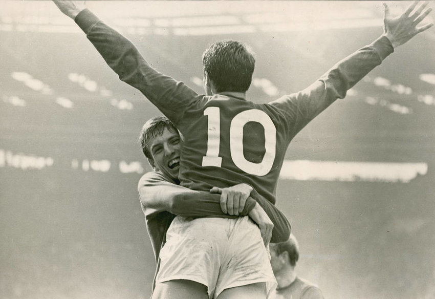 Martin Peters and Geoff Hurst (back turned) celebrate at the 1966 World Cup.  Hurst remains the only player in Cup history to score a hat-trick in a final match.  England defeated Germany 4-2 and would never wear the crown again.