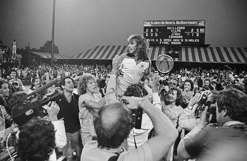 Guillermo Vilas is hoisted after defeating Jimmy Connors at the 1977 US Open.  It was the last Open tournament played at the storied West Side Tennis Club before moving to its current location in Fresh Meadows, Queens.