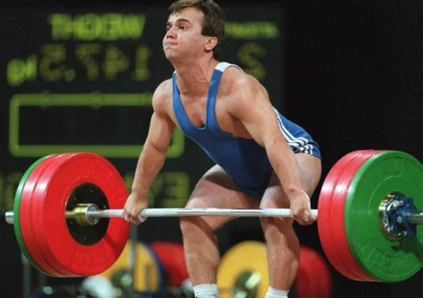 """Naim Suleymanoglu, nicknamed the """"Pocket Hercules"""" for his small stature and brute strength.  One of the greatest weightlifters of all time, he was the protégé of Coach Ivan Abatchiev, pioneer of the successful 'Bulgarian Method'."""