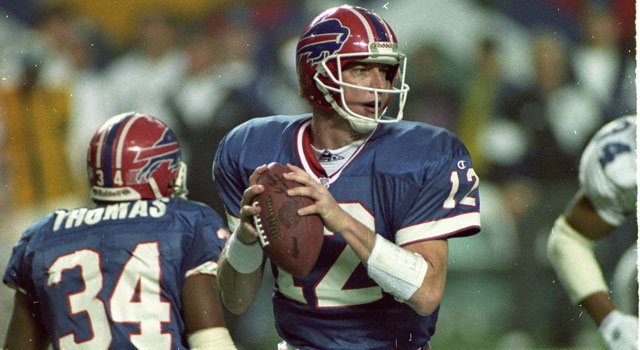 Buffalo Bill's Jim Kelly poised for a throw in Super Bowl XXVIII against the Dallas Cowboys.  He is the only QB in NFL history to start in four consecutive Super Bowl games.  Sports History Magazine interviewed Jim on his playing days.