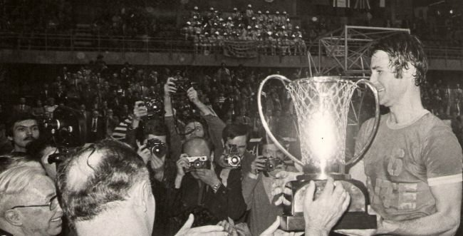 Tal Brody displays the EuroCup trophy to the world media after leading the Maccabi Tel-Aviv basketball team to victory at the 1977 European Cup championship.  An emotional moment for the country, it was Israel's first win at the premier tournament for club competition.