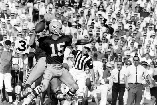 Green Bay Packers' Bart Starr preparing a throw at the AFL-NFL World Championship Game, which later became Super Bowl I.  The Packers defeated the Kansas City Chiefs 35-10 in what was seen at the time as an inconsequential match between two rival leagues.