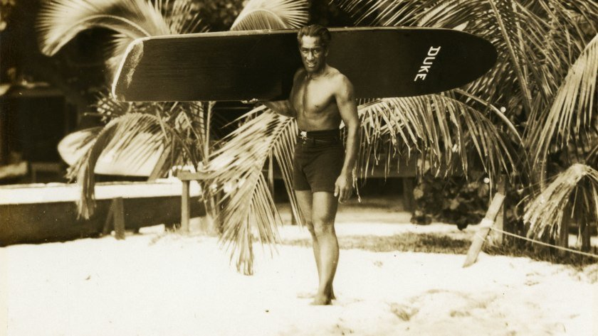 "Duke Kahanamoku captured with his surfing board in Hawaii.  A 3-time Olympic gold medalist in swimming and surfing's first global ambassador, the Hawaiian legend is the subject of David Davis' biography, ""Waterman: The Life and Times of Duke Kahanamoku""."