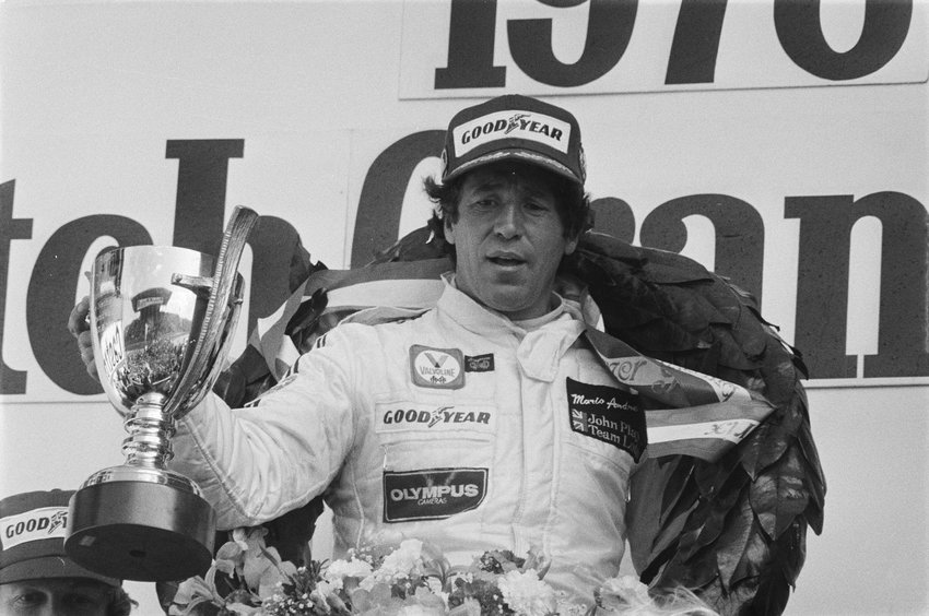 Mario Andretti celebrating his victory at the 1978 Dutch Grand Prix, the last F1 race won by an American.  A legend behind the wheel, Andretti is the only race car driver to win the Daytona 500 (1967), Indianapolis 500 (1969), and the Formula One World Championship (1978).